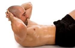 The classic sit-up exercise for toning the abdominal region